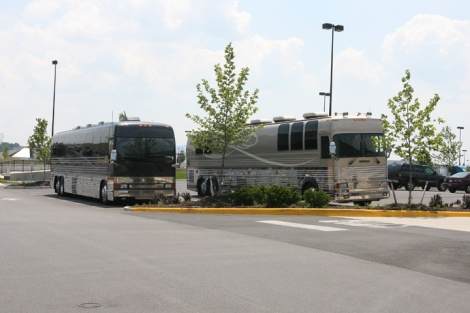 """There is a band bus, the crew bus and a bus for Josh and his wife. Jennifer has toured with Josh since I started the gig. There are usually three sections of a band or crew bus. There is the front lounge, the bunk area and the back lounge. Most of the buses are what they call 12-sleepers which means they come with 12 bunks or you can have like what we have they call 'condo bunks' and the bunks are larger and then you can only carry 8 bunks but that's the setup. We have satellite TV in the front and back lounges and video game systems and there is Wi-Fi on the bus and bathrooms and some of the buses have showers and little kitchens and microwaves. It's really a home away from home. There is no way we could do what we do without them. We'd be miserable."" Story next pg. WCR photo by Dan McDermott."